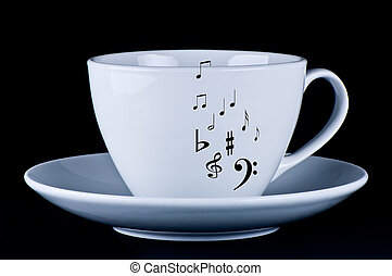 White cup with black musical notes  black background