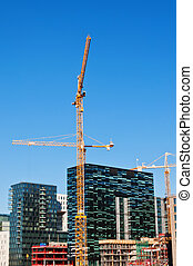 Buildings with two tower cranes - Building of buildings with...