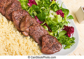 Tenderloin steaks in wine sauce with cadamon and kuskus...