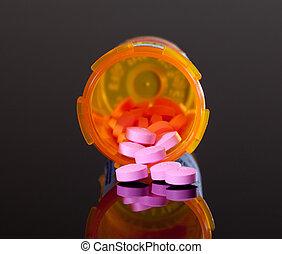 Purple pills from orange drug bottle - Set of round purple...