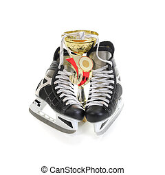 Hockey skates and cup winner Isolated on white background