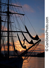 Close up ship silhouette at sunset - Close up tall ship...