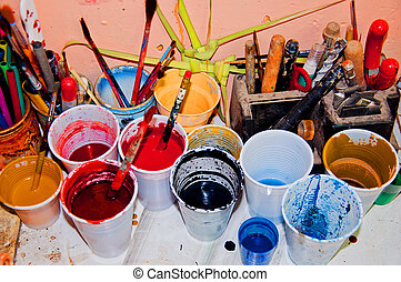 Paint in plastic cups - Plastic cups with paint on table in...