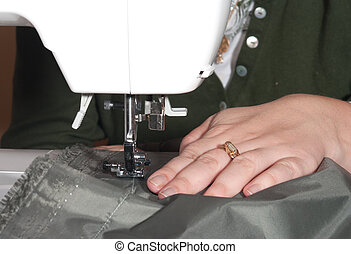 Sewing. - Female hands sewing on a machine.