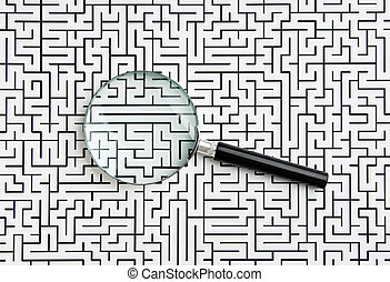 magnifying glass and labyrinth - magnifying glass on the...