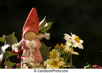 christmas elf among winter flowers - background christmas...