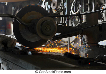 abrasive disk machine - sharpening and cutting of iron by...