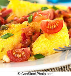 Polenta slices with Hogao, also called Criollo Sauce, which...
