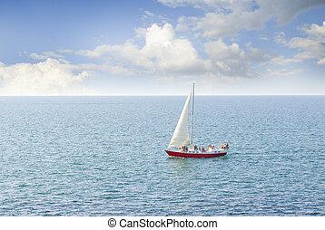 sailboat sailing in ocean