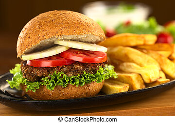 Vegetarian lentil burger in wholewheat bun with lettuce,...