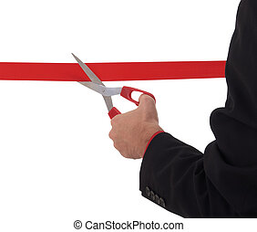 Grand opening ceremony - business man cutting a red ribbon...