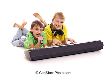 little boys at synthesizer - portrait of a little boys at...