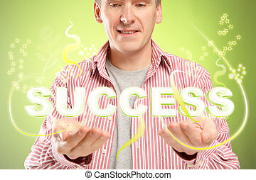 Success - Man with word sucess over his hands Concept of...
