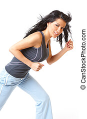 Young woman running on studio white isolated background
