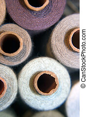 Sewing threads - Spools of colorful sewing threads, macro...