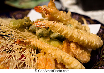 Tempura Prawn and assorted vegetables lay golden on the...
