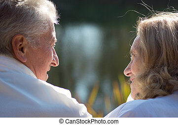 old couple at nature - portrait of an old couple at nature