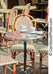 Consumption over. an outdoor cafe in France
