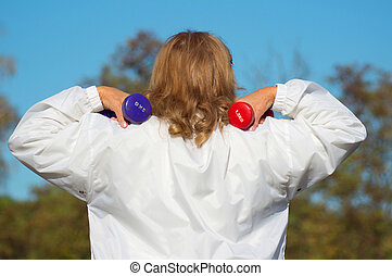 aged woman with dumb bells - old woman with dumb bells at...