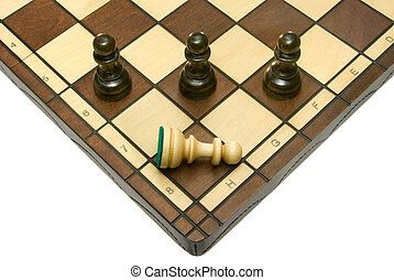 Defeat - Pawns (three black and one white) on a chess board....