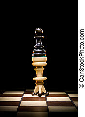 Change of authority - Pawn and a queen on a chess board. A...