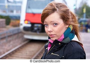 Teenage Girl Commuting - Teenage girl at railway platform,...