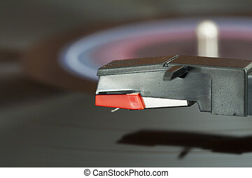 Turntable - Closeup of needle over a wheeling record on a...