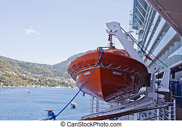Orange Lifeboat with Blue Rope on Cruise Ship - An orange...