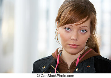 Teenage Girl Portrait - Teenage girl in modern building,...