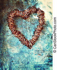 grunge heart on blue wall - rusted wire heart wreath on...
