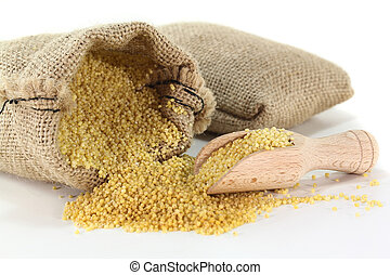 Millet - a sack of millet on a light background