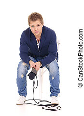 guy and microphone - cute young man with microphone on white