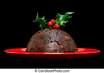 Christmas pudding with holly isolated on black