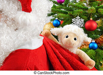 Sweet stuffed animal in Santa's bag - Cute stuffed sheep...