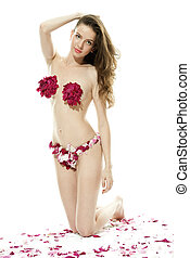 Girl dressed with flowers - A beautiful girl in a swimsuit...
