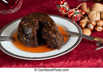 Christmas pudding with brandy - Christmas dinner table with...