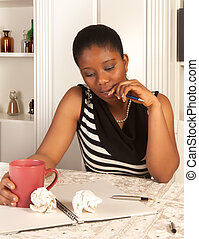 Pensive woman writing - Pensive african woman writing a...