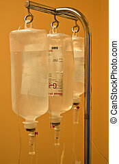 Infusion bottles hanging on metal holder in line