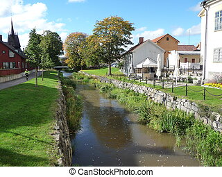 Canal in Sderkping Sweden - Canal and green grass in a...