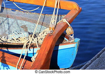 details of an old fishing boat sailing out of wood