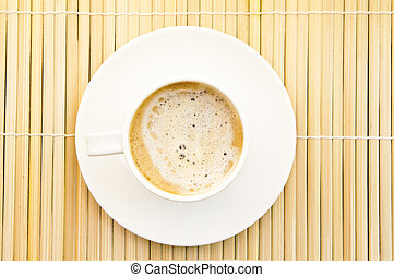 Top view of cup coffee on bamboo background