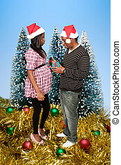 Black Couple Opening a Christmas or birthday present