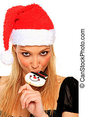 sexy christmas girl bites a candy - sexy christmas girl...