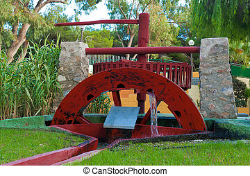 Water mill - Traditional old water mill rotating with...
