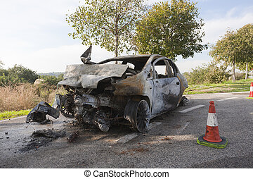 Burning car - Wrecked and burning car on the road