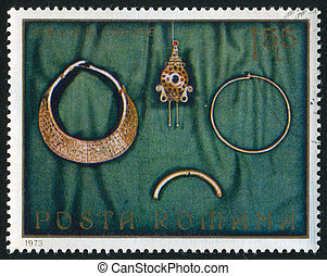 Necklaces and fibula - ROMANIA - CIRCA 1973: stamp printed...