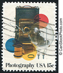 photo camera - UNITED STATES - CIRCA 1978: stamp printed by...