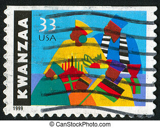 Kwanzaa celebration - UNITED STATES - CIRCA 1999: stamp...