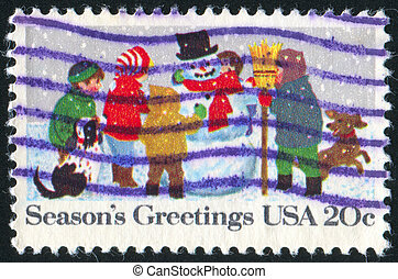 children with snowman - UNITED STATES - CIRCA 1982: stamp...