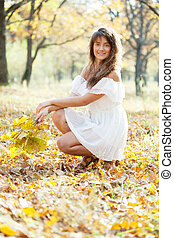 long-haired girl  in autumn